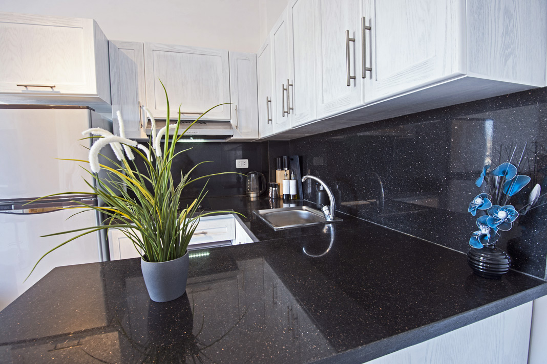 Black quartz effect laminate kitchen worktop