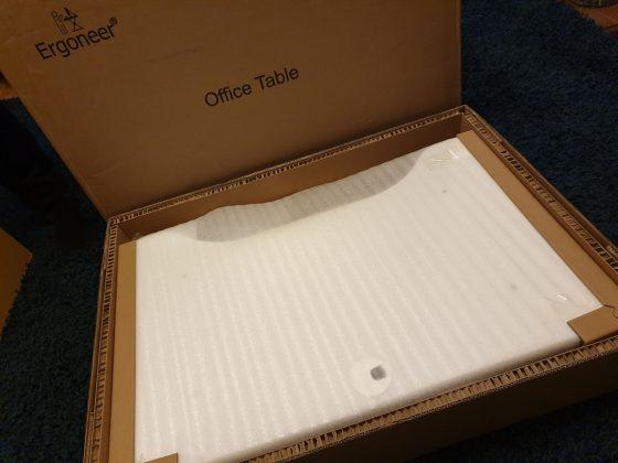 unboxing white standing desk